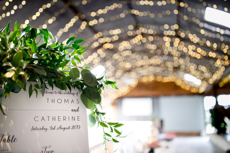 Table plan at Cripps stone Barn, green foliage and fairy lights
