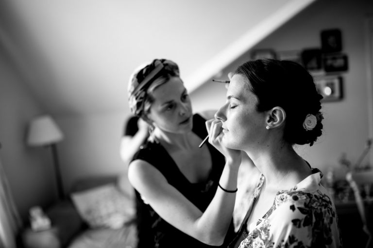 bride having her make up done professionally in cotham bristol before wedding at goldney hall
